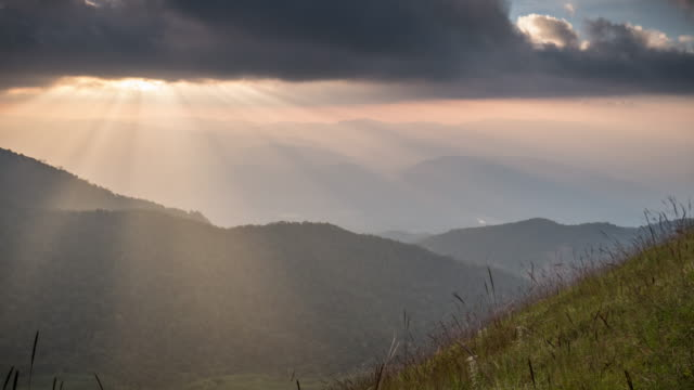 Sunset on the mountain with sunlight ray , Time Lapse movement