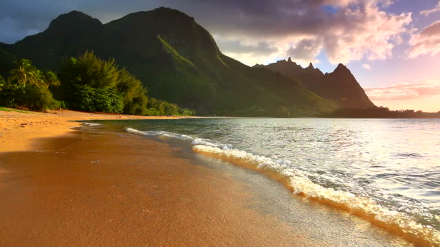 sunset on the north shore of kauai-tunnels beach, hawaii - kauai stock videos & royalty-free footage