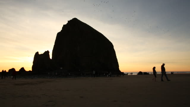 a sunset on the oregon coast and pacific ocean. - haystack rock stock videos & royalty-free footage