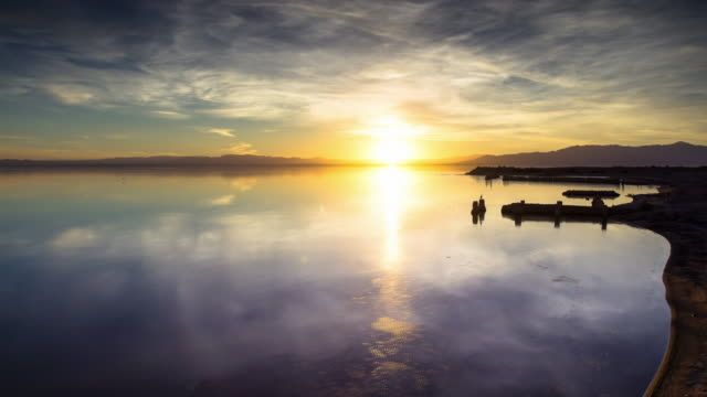 sunset on the salton sea - timelapse - bright colour stock videos & royalty-free footage