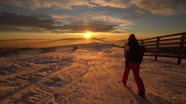 sunset on the snowy mountain - ski clothing stock videos and b-roll footage