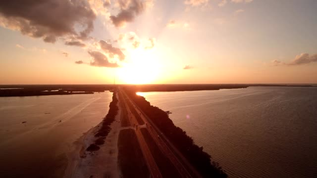 sunset over a beach in tampa florida - tampa stock videos & royalty-free footage
