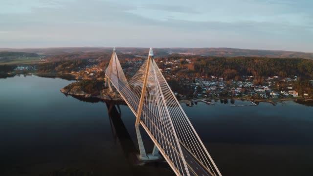 solnedgång över en vacker bro i sverige - bro bildbanksvideor och videomaterial från bakom kulisserna