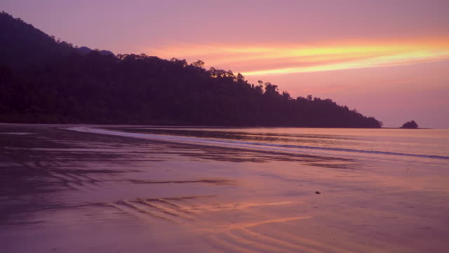Sunset over a tropical beach on Langkawi Island in the Andaman sea in Malaysia