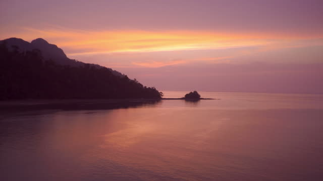 sunset over a tropical beach on langkawi island in the andaman sea in malaysia - langkawi stock videos and b-roll footage