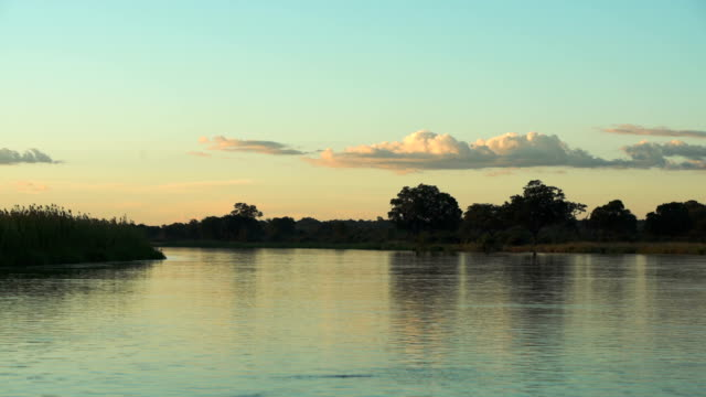 Sunset over African river.