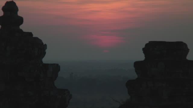 ws zo sunset over angkor wat, angkor wat, cambodia - angkor stock videos and b-roll footage