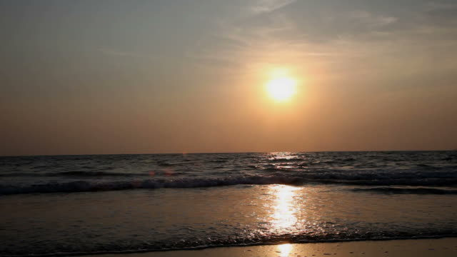 sunset over arossim beach, goa, india. - sea robin stock videos & royalty-free footage