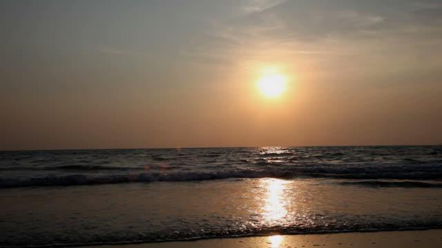 sunset over arossim beach, goa, india. - sea robin bildbanksvideor och videomaterial från bakom kulisserna