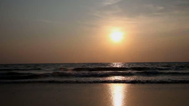 Sunset over Arossim Beach, Goa, India.
