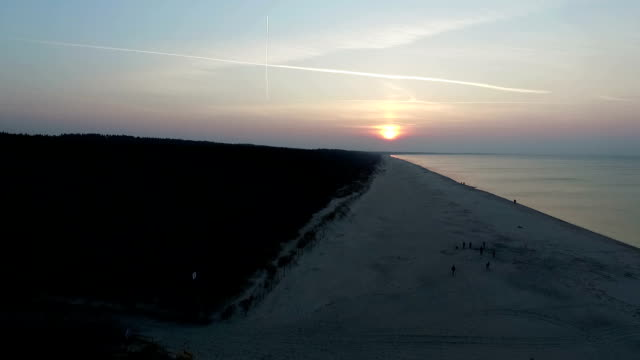 sunset over baltic beach - baltic countries stock videos and b-roll footage