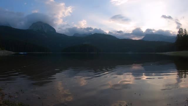 sunset over black lake, montenegro - durmitor national park stock videos & royalty-free footage