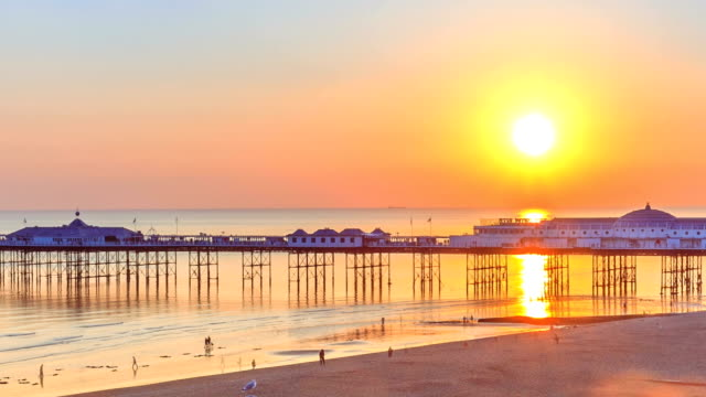 sunset over brighton wheel and pier - brighton england stock videos and b-roll footage