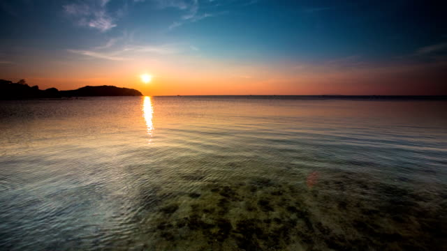 sunset over calm sea - ko phangan stock videos and b-roll footage
