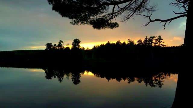 sunset over calm upper peninsula michigan lake - upper peninsula stock videos & royalty-free footage