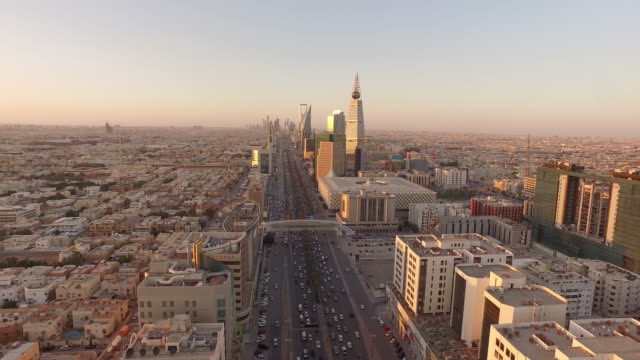 sunset over central riyadh, looking down king fahd road, saudi arabia - saudi arabia stock videos and b-roll footage
