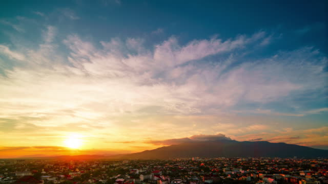 sunset over chiang mai city 4k time lapse - chiang mai city stock videos and b-roll footage