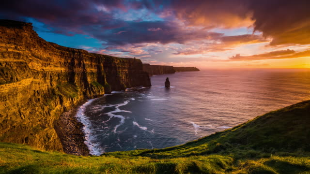 sunset over cliffs of moher in ireland - time lapse - cliff stock videos & royalty-free footage