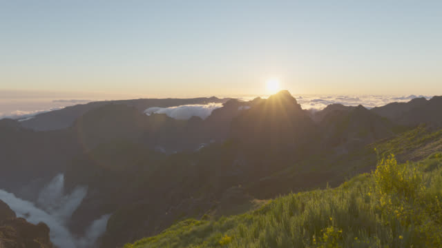 sunset over clouds and volcanic landscape - madeira stock videos and b-roll footage