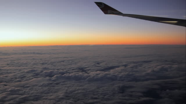 ws sunset over clouds seen from boeing 747, airplane wing in foreground - aircraft wing stock videos & royalty-free footage