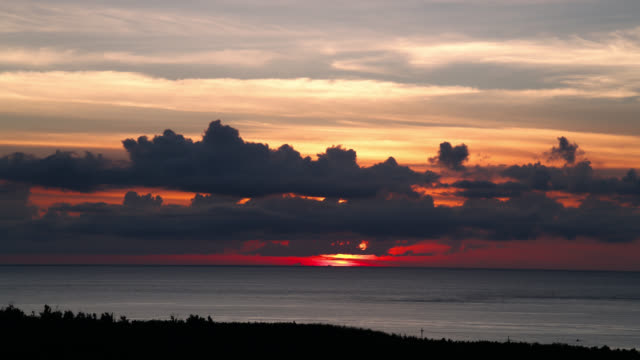 sunset over coast, japan. - okinawa prefecture stock videos & royalty-free footage