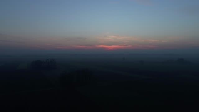ws sunset over darkening rural landscape,prekmurje,slovenia - prekmurje stock videos & royalty-free footage