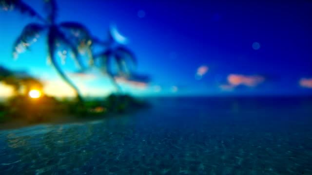 Sunset over defocused tropical ocean (loopable)