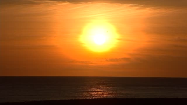 sussex hastings ext gvs sunset setting sun over sea - sunset stock videos & royalty-free footage