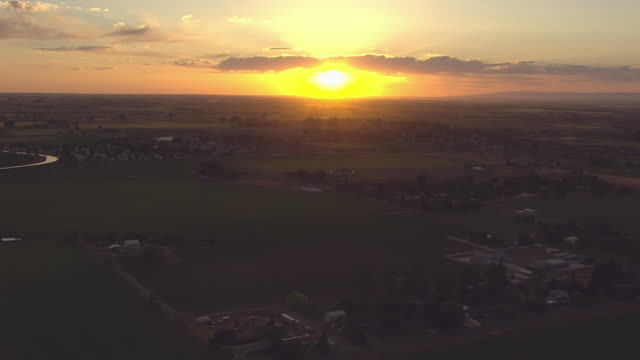 ws aerial sunset over fields and city / twin falls, idaho, united states - idaho stock videos & royalty-free footage