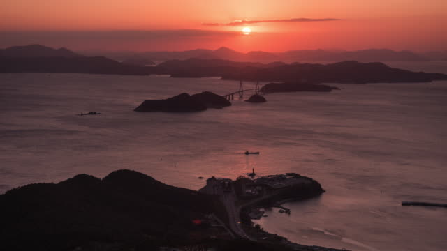sunset over gadeokdo island service area and busan-geoje bridge / gangseo-gu, busan, south korea - pink colour bildbanksvideor och videomaterial från bakom kulisserna