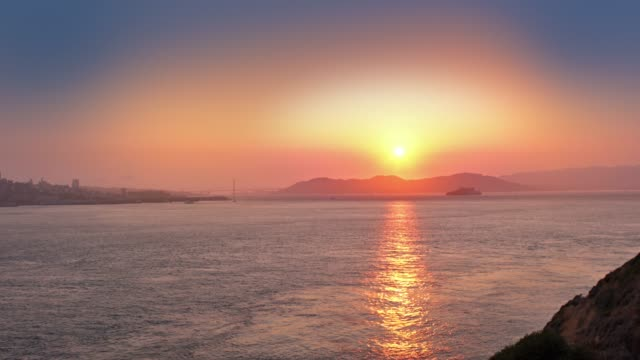 sunset over golden gate bridge - northern california stock videos & royalty-free footage
