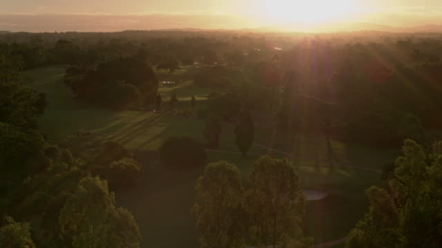 sunset over golf course and parkland - lake stock videos & royalty-free footage