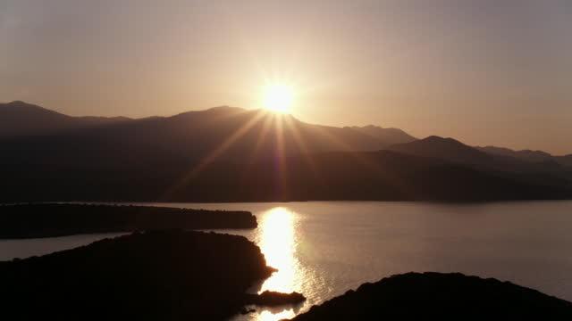 sunset over greek coastline - greece stock videos & royalty-free footage