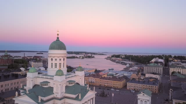 sunset over helsinki cathedral in finland - finlandia video stock e b–roll