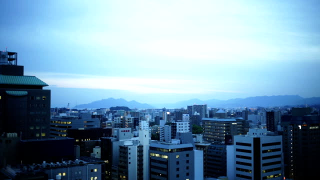 sunset over hiroshima buildings - hiroshima prefecture stock videos and b-roll footage