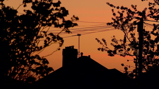 sunset over houses during coronavirus lockdown - 30 seconds or greater stock videos & royalty-free footage