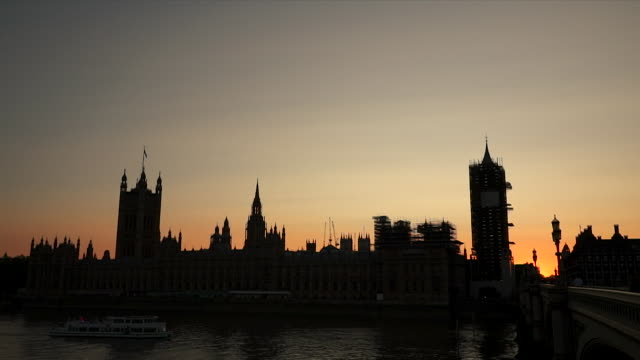 sunset over houses of parliament, london - silhouette stock videos & royalty-free footage