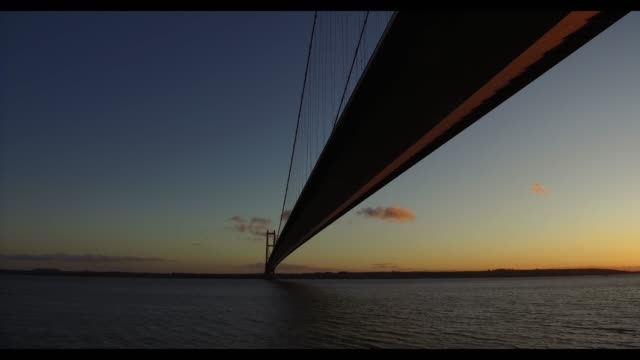 sunset over humber bridge - metal blend stock videos and b-roll footage