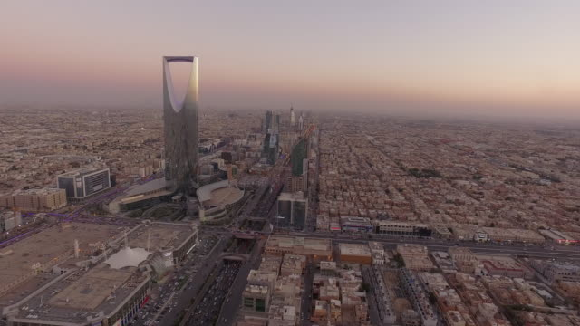 sunset over kingdom tower in central riyadh, saudi arabia - saudi arabia stock videos and b-roll footage
