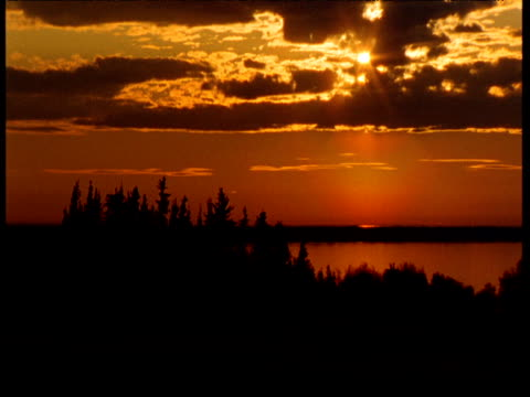 sunset over lake athabasca, saskatchewan - saskatchewan stock videos and b-roll footage