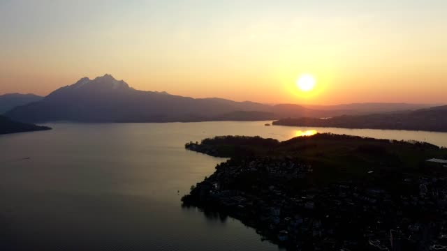 sunset over lake lucerne in switzerland - lake lucerne stock videos & royalty-free footage