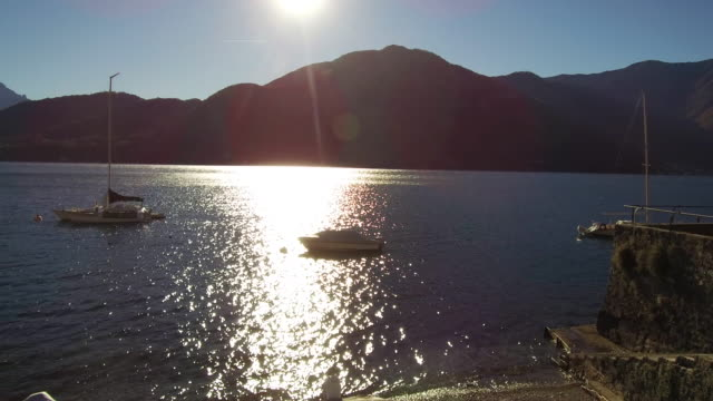 sunset over lake of como - promenade stock videos & royalty-free footage