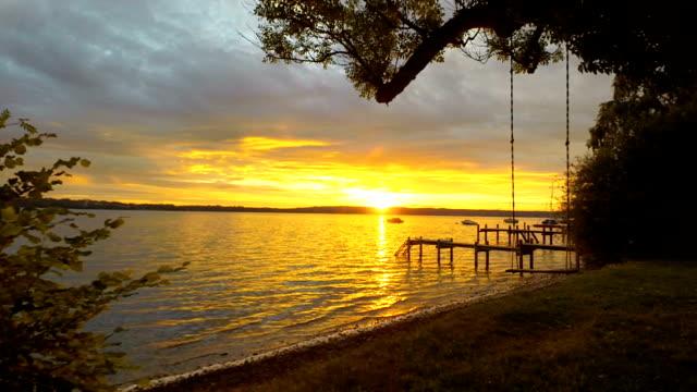 sunset over lake starnberg - jetty stock videos & royalty-free footage