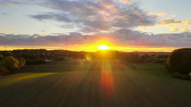 sunset over land - yellow stock videos & royalty-free footage