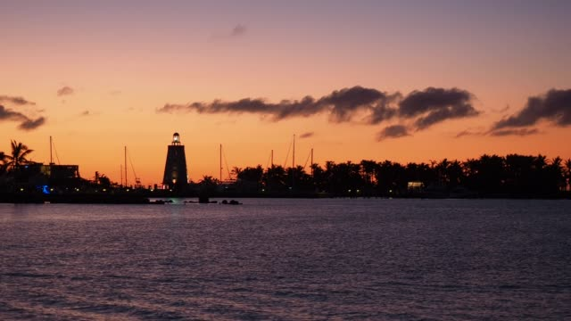sunset over lighthouse in marathon key - the florida keys stock videos & royalty-free footage