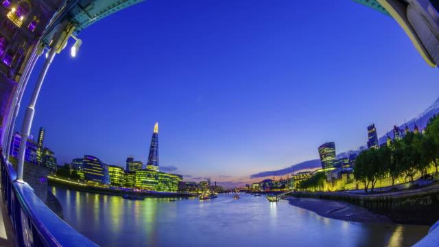 Sunset over London skyline seen from Tower Bridge.