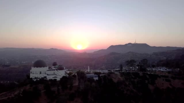 sunset over los angeles observatory and hollywood sign - observatory stock videos and b-roll footage
