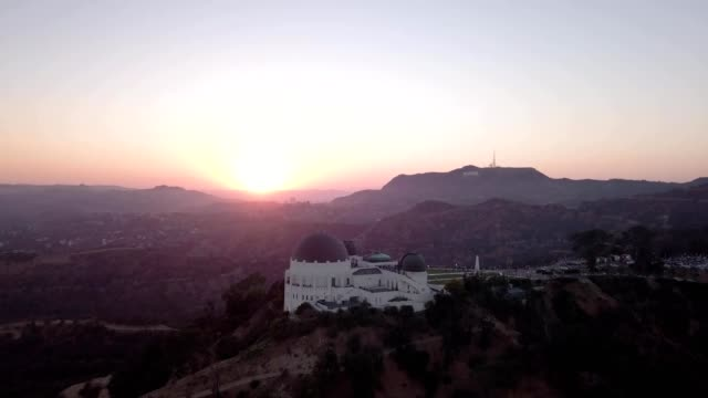 sunset over los angeles observatory - observatory stock videos and b-roll footage