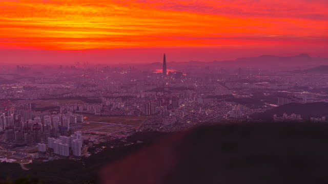 sunset over lotte world tower view from namhansanseong fortress / jamsil, songpa-gu, seoul, south korea - fortezza video stock e b–roll