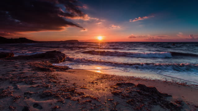 sunset over mediterranean sea - ultra high definition television stock videos & royalty-free footage